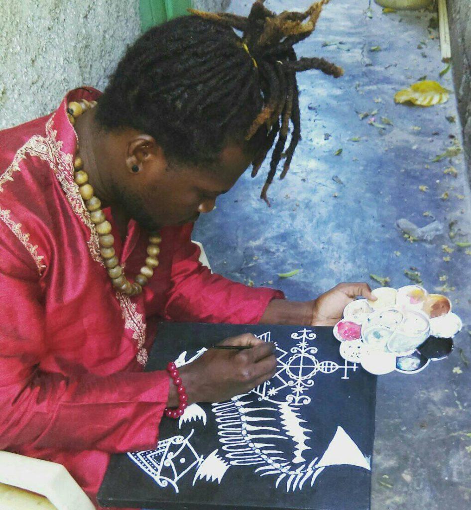 Sanon Jeanwildert paints Simbi veve